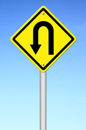 Yellow warning sign u-turn roadsign with blue sky background Stock Photo - 14660616