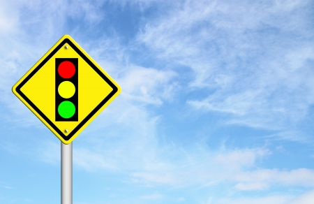 Traffic light ahead warning sign with blue sky background blank for text photo