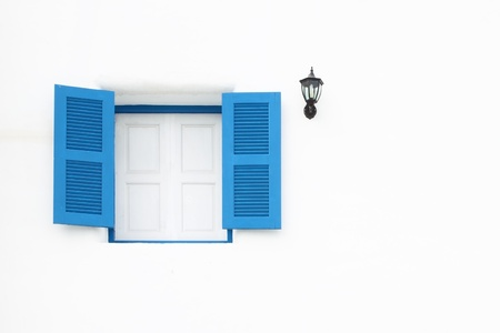 Greek Style windows and lamp on white wall photo