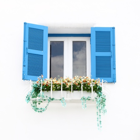 Greek Style windows and flower on white wall Archivio Fotografico