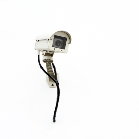 CCTV on white wall background photo