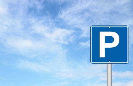 Parking traffic sign with blue sky blank for text photo
