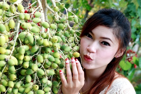 asian women with betel palm photo