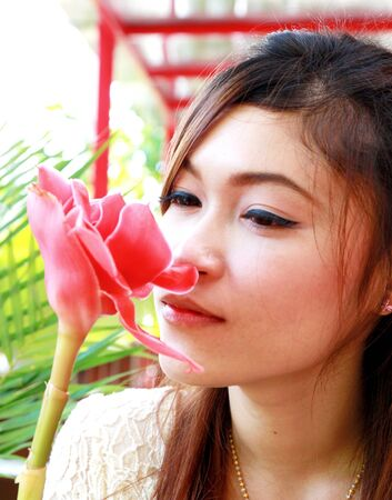 portrait of asian woman with pink flower photo