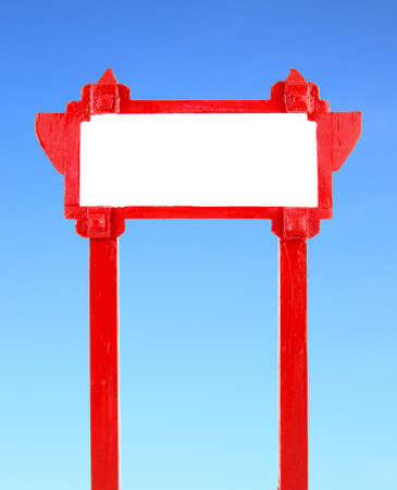 red blank wooden sign with blue sky photo