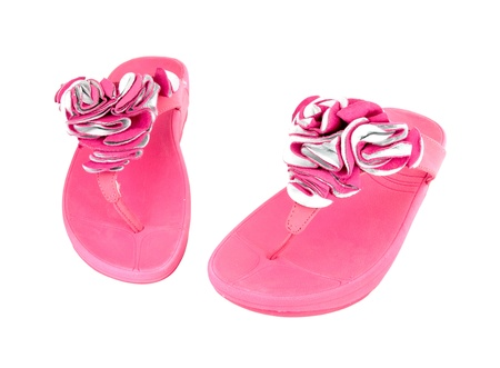 footware: pink slippers on white background