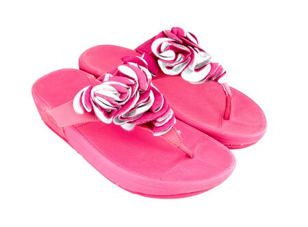pink slippers on white background photo