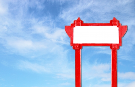 red blank wooden sign with blue sky blank for text photo