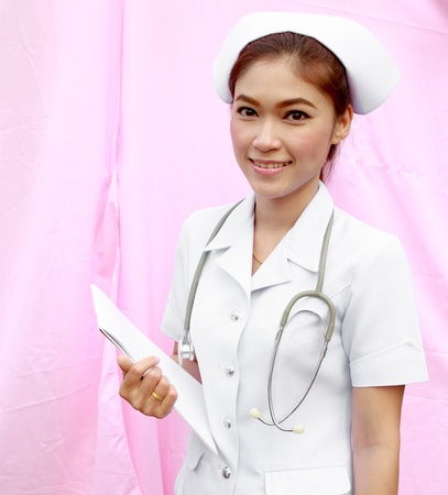 young nurse holding medical report and stethoscope photo