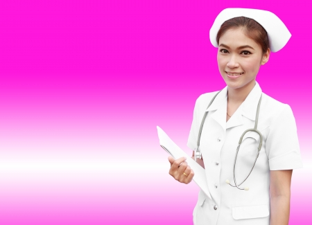 young nurse holding medical report on pink background photo