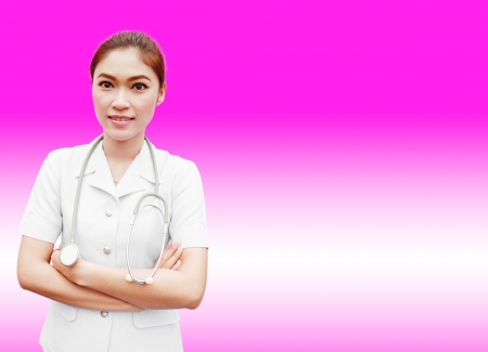 Young nurse with stethoscope on pink background photo