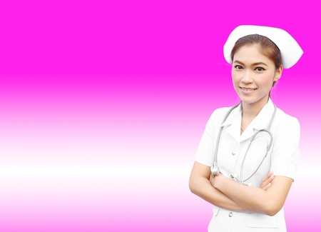 Female nurse standing with stethoscope on pink background Stock Photo - 15264579