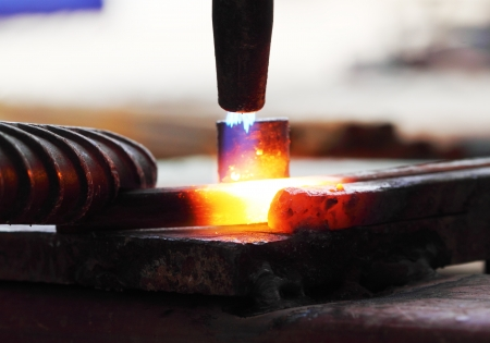 Gas heating cutting metal using torch and bending square bar Stock Photo - 15303244