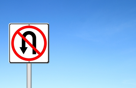 No return back road sign over blue sky blank for text photo