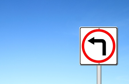 obey: left turn road sign over blue sky blank for text