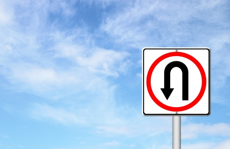 uturn: Turn back road sign over blue sky blank for text