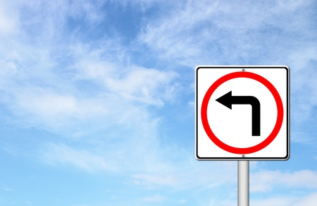 left turn road sign over blue sky blank for text photo