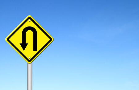 u turn sign: Yellow warning sign u-turn roadsign with blue sky background blank for text Stock Photo