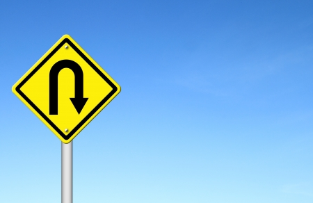 u turn: Yellow warning sign u-turn roadsign with blue sky background blank for text Stock Photo