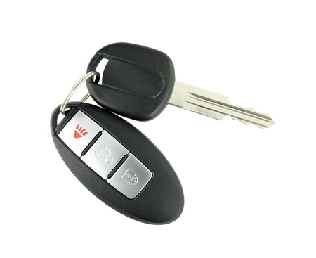 car key with remote control on white photo