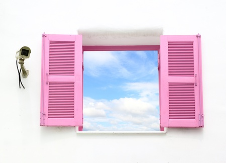 Greek style windows with cctv and blue sky view photo