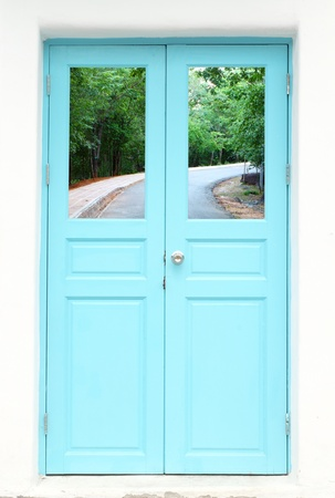 Greek style door with curve road view photo