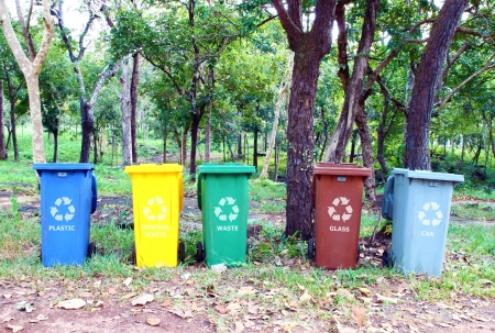 five colors recycle bins in the park Stock Photo - 16052556