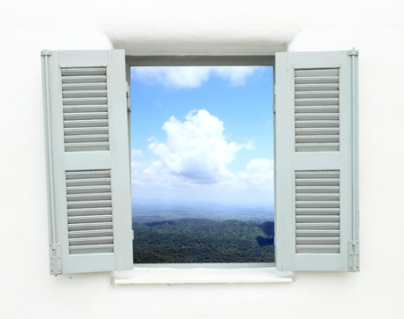 Greek style window with mountain and sky view photo