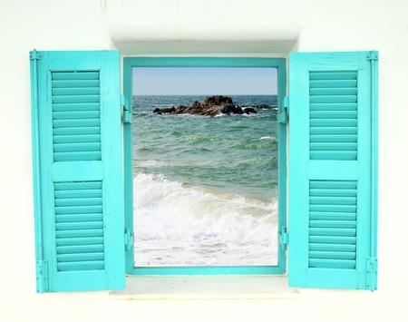 blue Greek style window with sea view Archivio Fotografico