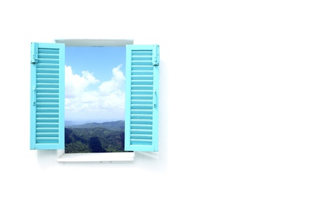 blue Greek style window with mountain and sky view photo