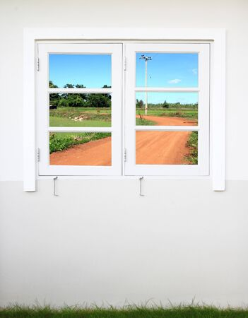 white wooden window with soil curve road view photo