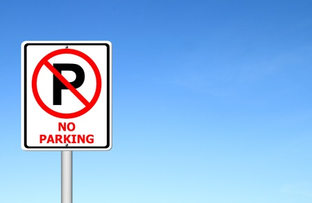 traffic pole: no parking sign with blue sky blank for text Stock Photo