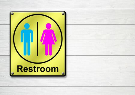 golden restroom sign on white wooden wall background photo