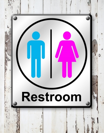 silver restroom sign on white wooden wall background photo