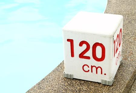 cm: 120 cm. water depth sign at swimming pool