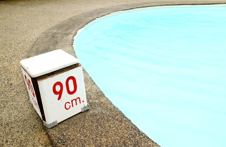 90 cm. water depth sign at swimming pool photo