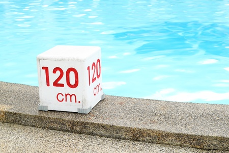 120 cm. water depth sign at swimming pool photo
