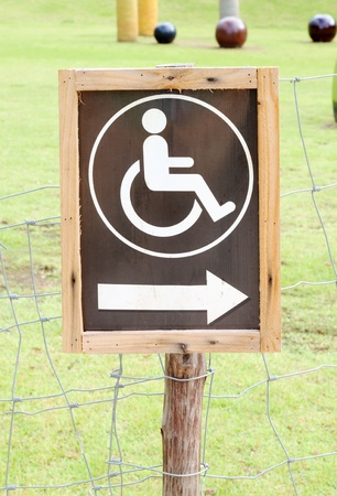 crippled: wood sign for invalid person entry in the park