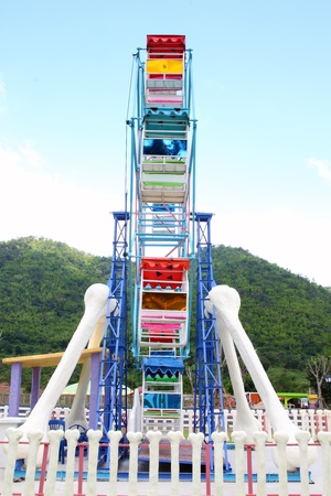 a colourful ferris wheel in the park  side view  photo