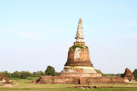 ancient pagoda in ruined old temple at Ayutthaya historical park, Ayutthaya, Thailand photo