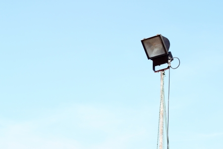 a flood light with blue sky photo