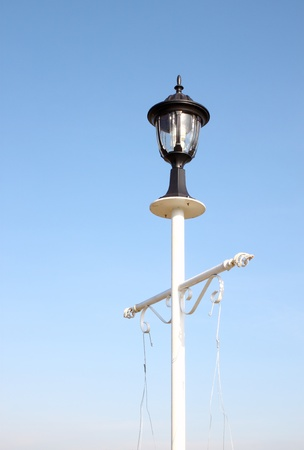 vintage lamp post against blue sky background photo