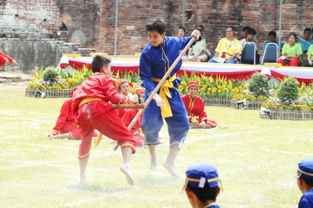swordfight: LOPBURI, THAILAND - FEB 16: Siamese soldiers fight one on one show at the King Narai Reign Fair on February 16, 2013 in Lopburi, Thailand