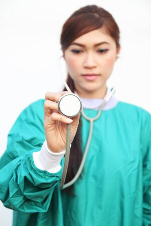 female doctor wearing a green scrubs and stethoscope on white background Stock Photo - 18521688