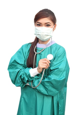female doctor wearing a green scrubs and stethoscope on white background photo