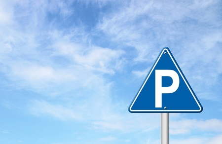 signal pole: parking sign with blue sky blank for text