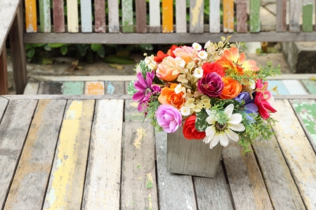 colorful flowers pots decoration on wooden table photo