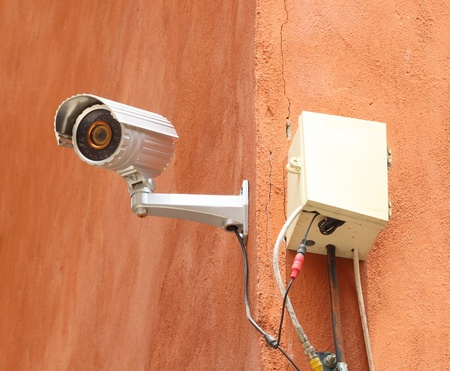 security camera CCTV and box control on the wall photo