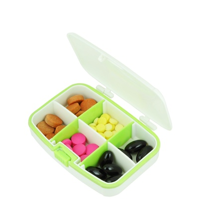 pills in pill box on white background photo