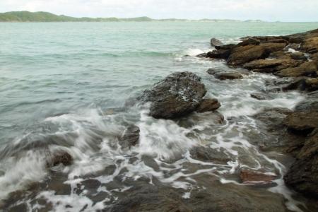 thailand flood: sea waves and stone, Thailand Stock Photo